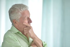 Senior man hand on chin Royalty Free Stock Photo