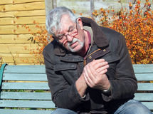 Senior man with hand pain. Stock Photography