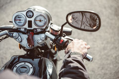 Senior man hand steering motorcycle on road Royalty Free Stock Photo