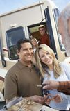 Senior Man Handing RV Keys To Couple Royalty Free Stock Photos