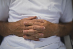 Senior man with hands clasped Royalty Free Stock Images