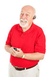 Senior Man with Hands Free Set Royalty Free Stock Photography