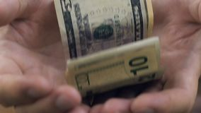 Senior man hands holding few dollars banknotes, poverty concept, close-up. Stock footage stock video footage