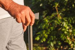 Senior man hands holding stick close up Royalty Free Stock Photography