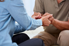 Senior man hands. Old aged senior men hands with social worker woman Royalty Free Stock Images