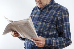 Senior man hands with reading newspaper Royalty Free Stock Image