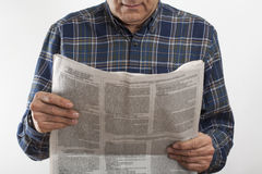 Senior man hands with reading newspaper Royalty Free Stock Photography