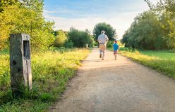 Senior man and happy child running outdoors Royalty Free Stock Photos