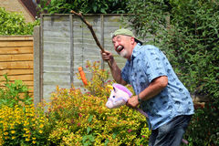 Senior man happy and laughing playing. Royalty Free Stock Images