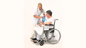 Senior man has a nurse visit stock footage