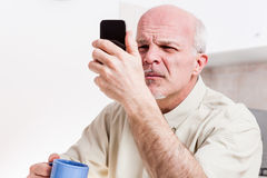 Senior man has problems with his vision Stock Image
