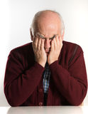 Senior man has problems. Old senior man having problems, thinking, beeing serious Royalty Free Stock Image