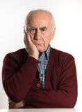 Senior man has problems. Old senior man having problems, thinking, beeing serious Royalty Free Stock Photos