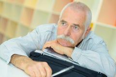 Senior man has sad look on face. Senior man has a sad look on his face royalty free stock photography