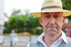 Senior man with hat looking neutral Stock Photos