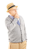 Senior man with hat in thoughts Stock Photography