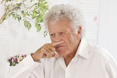 Senior man having allergy Royalty Free Stock Image