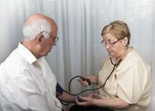 Senior people blood pressure check Stock Photography