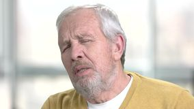 Senior man having breath shortness. Close up older man suffering from heart ache. Causes of heart arrest stock footage