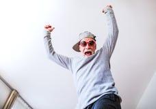 Senior man having fun at home. Crazy senior man having fun at home stock image