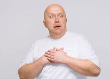 Senior man having heart attack isolated on white Stock Photo