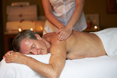 Senior Man Having Massage In Spa Royalty Free Stock Images