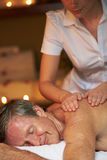 Senior Man Having Massage In Spa Royalty Free Stock Photography