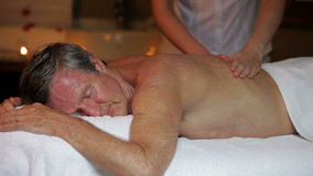 Senior Man Having Massage In Spa. Senior man relaxing with massage at beauty spa.Shot on Canon 5d Mk2 with a frame rate of 30fps stock footage