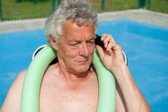 Senior man is having a serious telephone call Royalty Free Stock Image