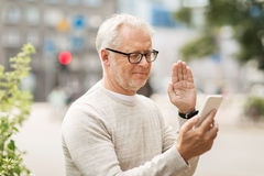 Senior man having video call on smartphone in city Royalty Free Stock Photography