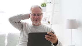 Senior man having video call on tablet pc at home 118 stock video