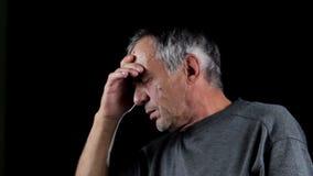 Senior man with headache stock footage