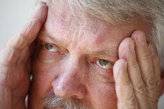 Senior man with headache closeup Royalty Free Stock Images