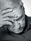 Senior man with a headache Royalty Free Stock Photos