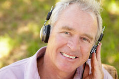 Senior man with headphone Royalty Free Stock Image