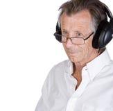 Senior Man with Headphones Stock Image