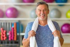 Senior man in health club Royalty Free Stock Image