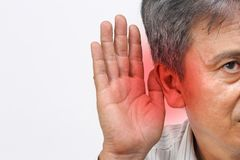 Senior man hearing loss , Hard of hearing. Isolated on white background stock images