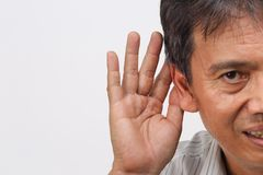Senior man hearing loss , Hard of hearing. On white background Stock Photo
