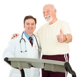 Senior Man Heart Healthy. Senior man and his doctor giving thumbs up because he has improved his health Royalty Free Stock Photography
