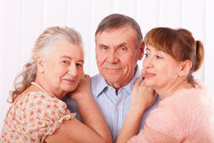 Senior man with her caregiver at home Stock Images