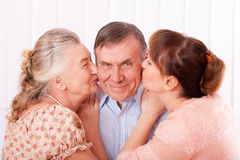 Senior man with her caregiver at home Royalty Free Stock Photos