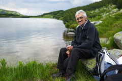 Senior man hiker having a break Stock Photo