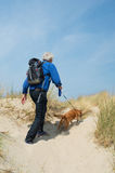 Senior man hiking with dog Stock Photos