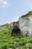 Senior man hiking into the mountains Royalty Free Stock Image