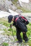 Senior man hiking into the mountains Stock Photos