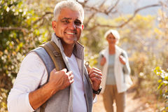 Senior man hiking wife. Handsome senior men hiking with wife stock photo