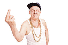 Senior man in hip-hop clothes, giving the finger Stock Images