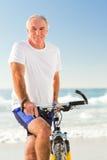 Senior man with his bike Stock Image