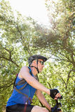 Senior man is on his bike in a forest Stock Photography